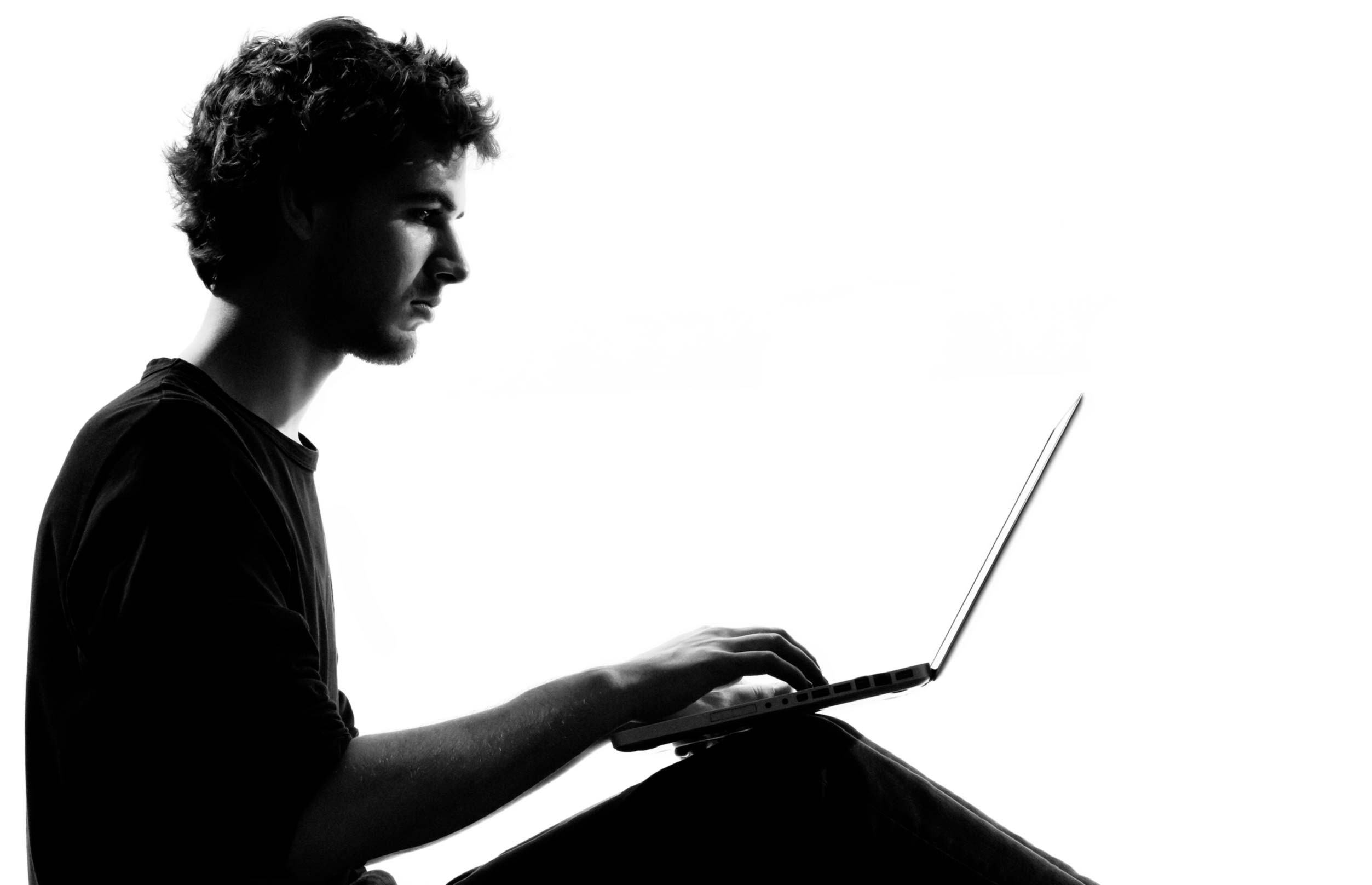 physiotherapy solutions - image of a man on Laptop
